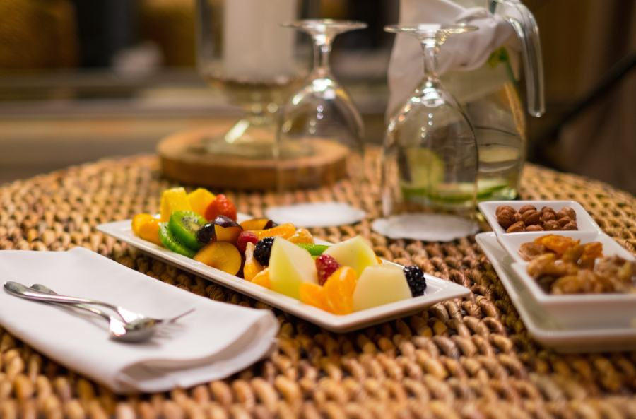 Plate with fresh fruits and refreshing drink on a table
